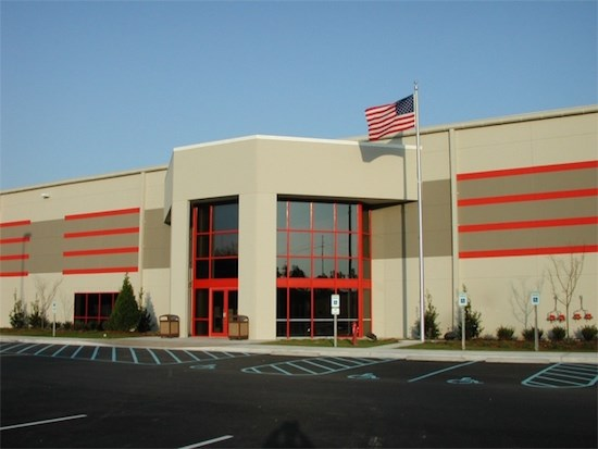 exterior of distribution center building with flag flying