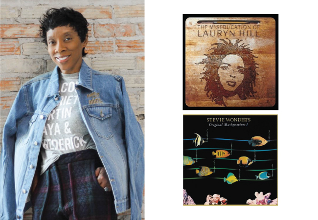 Terri wears a jean jacket over a grey shirt printed with leaders' names, alongside two album covers