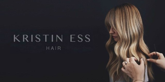 A pair of hands style a woman's long, blonde hair. At left, text reads Kristin Ess Hair