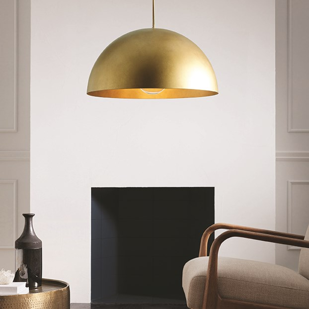 A gold dome light hangs in a living room