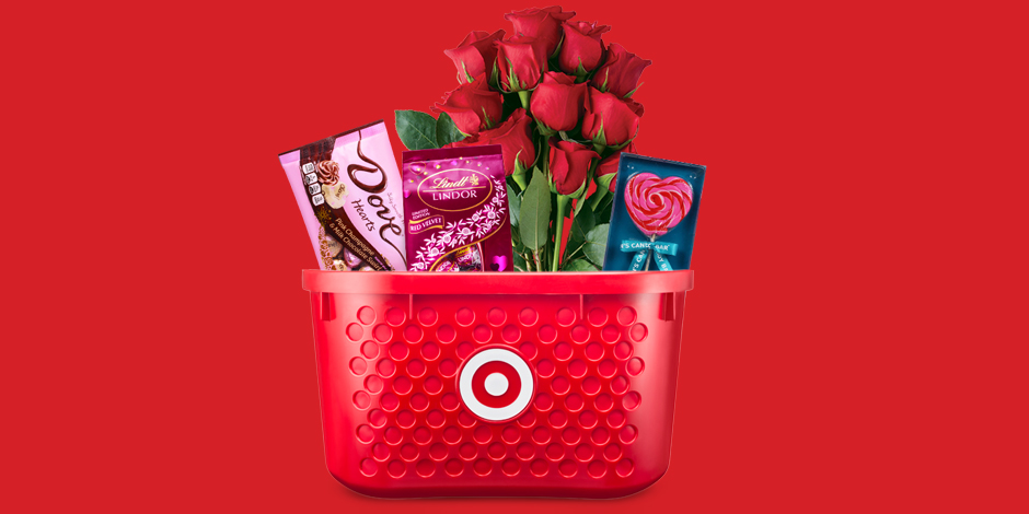 A red Target basket filled with chocolates, red roses and a candy heart lollipop
