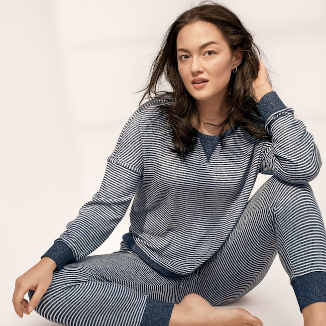 A woman models grey stripped pajamas