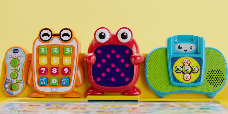 A closeup of characters and buttons on the Touch and Learn Activity Desk