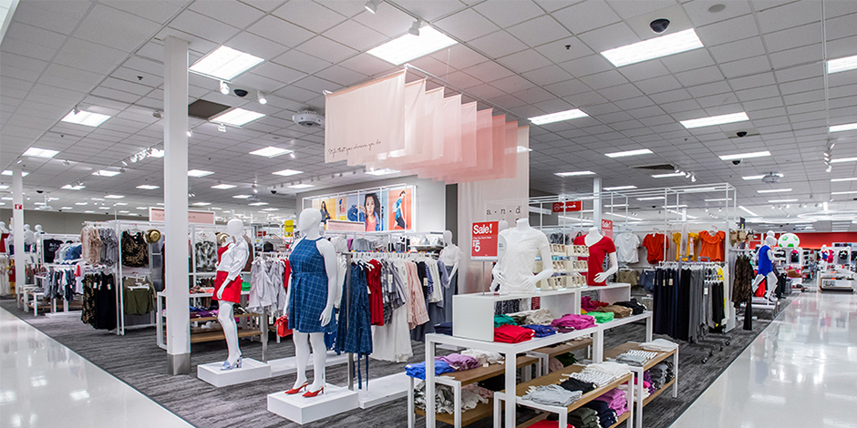 The sales floor in women's apparel and accessories with LED lights shining overhead