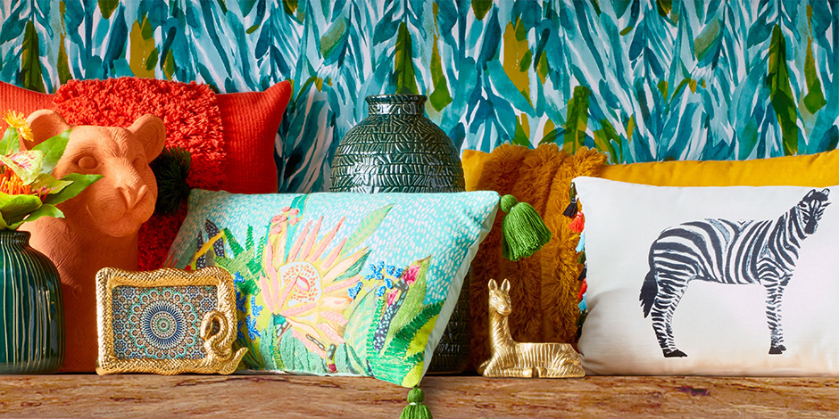 A shelf full of colorful Opalhouse products, from vases and photo frames to throw pillows