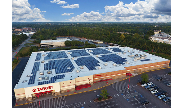 A birds-eye-view of a Target store with solar rooftop panels on the roof