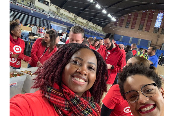 Cathia and her teammates take a selfie as they pack donations at an event