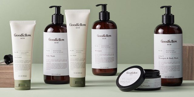 A variety of Goodfellow grooming products against a green background
