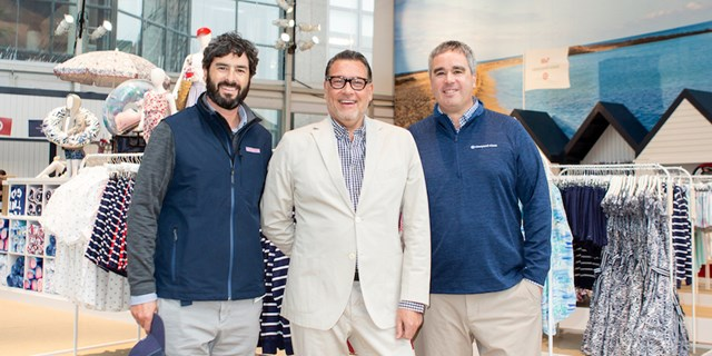 Vineyard Vines founders Shep and Ian Murray stand with Target's Mark Tritton at the event