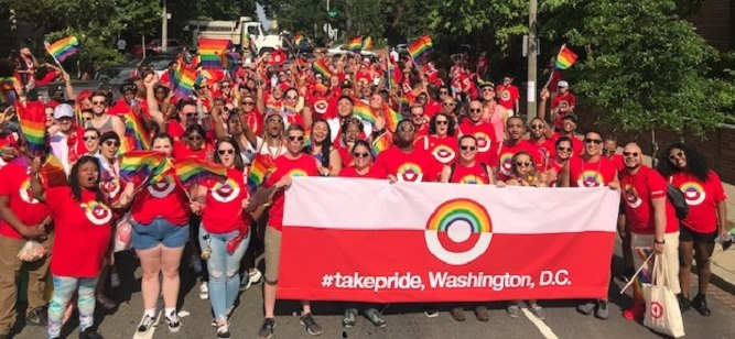 "Target team members carry a banner reading ""#takepride, Washington, D.C."""