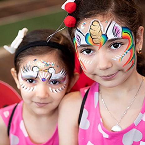 Two little girls with elaborate face paint
