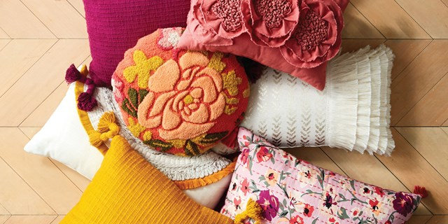 A stack of colorful, textured pillows
