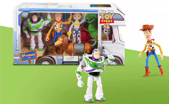 The RV play set package with Woody and Buzz figures posed next to it