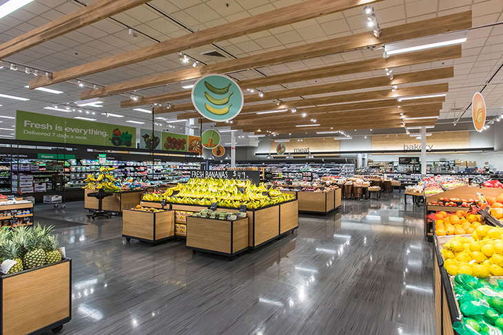A wide shot of the food and beverage area of a Target store with fresh produce on display