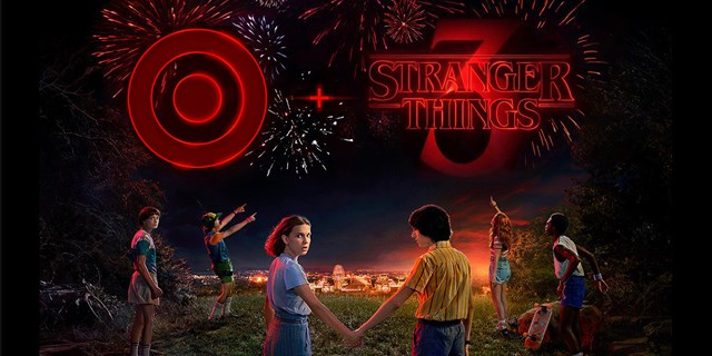 The cast of Stranger Things stand in front of the Stranger Things and Target logos in the sky