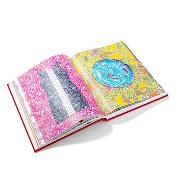 An open book showing stylized product against pink and yellow backgrounds