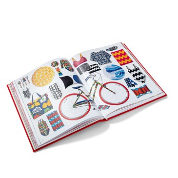 An open book showing a variety of products from the 20th Anniversary Collection