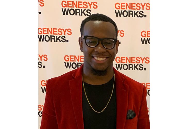 A head-and-shoulders shot of Davon standing in front of a Genesys Works background wall