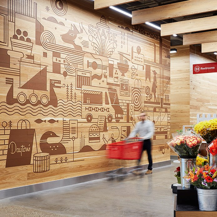 Iconic Minnesota icons etched into a wood wall in a Minneapolis store