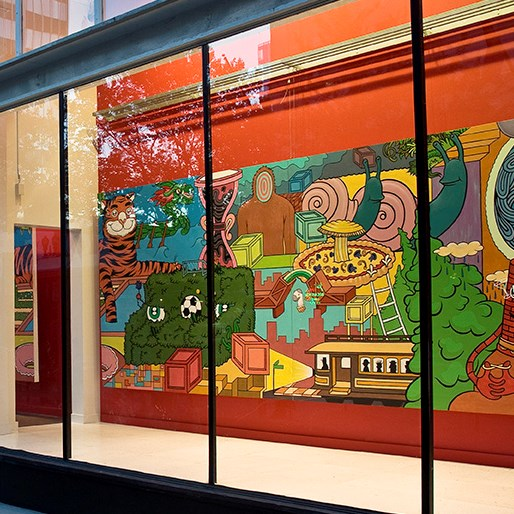 Colorful murals inside the windows of a Portland store