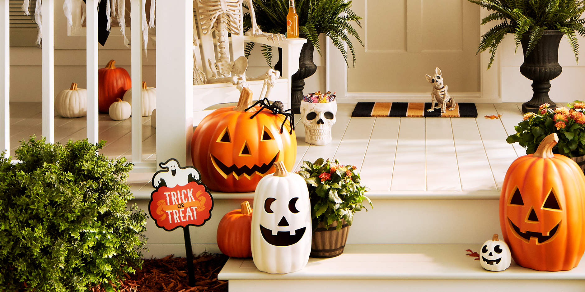 A front porch decorated in cheery Halloween pumpkin finds
