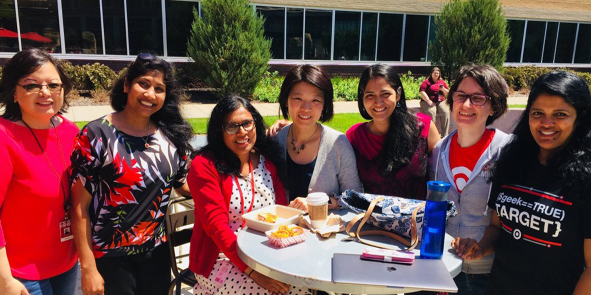 Members of Target's eMIP program stand together at a table outside of our headquarters