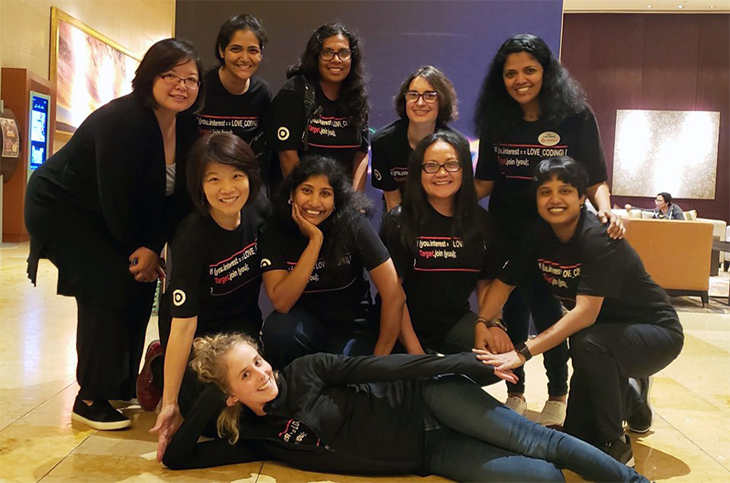 Ten women wearing Target Tech team t-shirts pose together in their workspace
