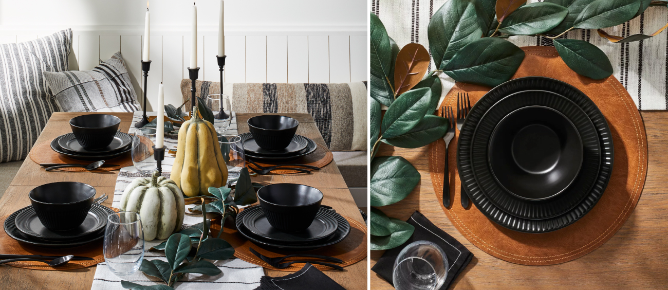 A modern tablescape, featuring black plates and accents  with pumpkins and greenery