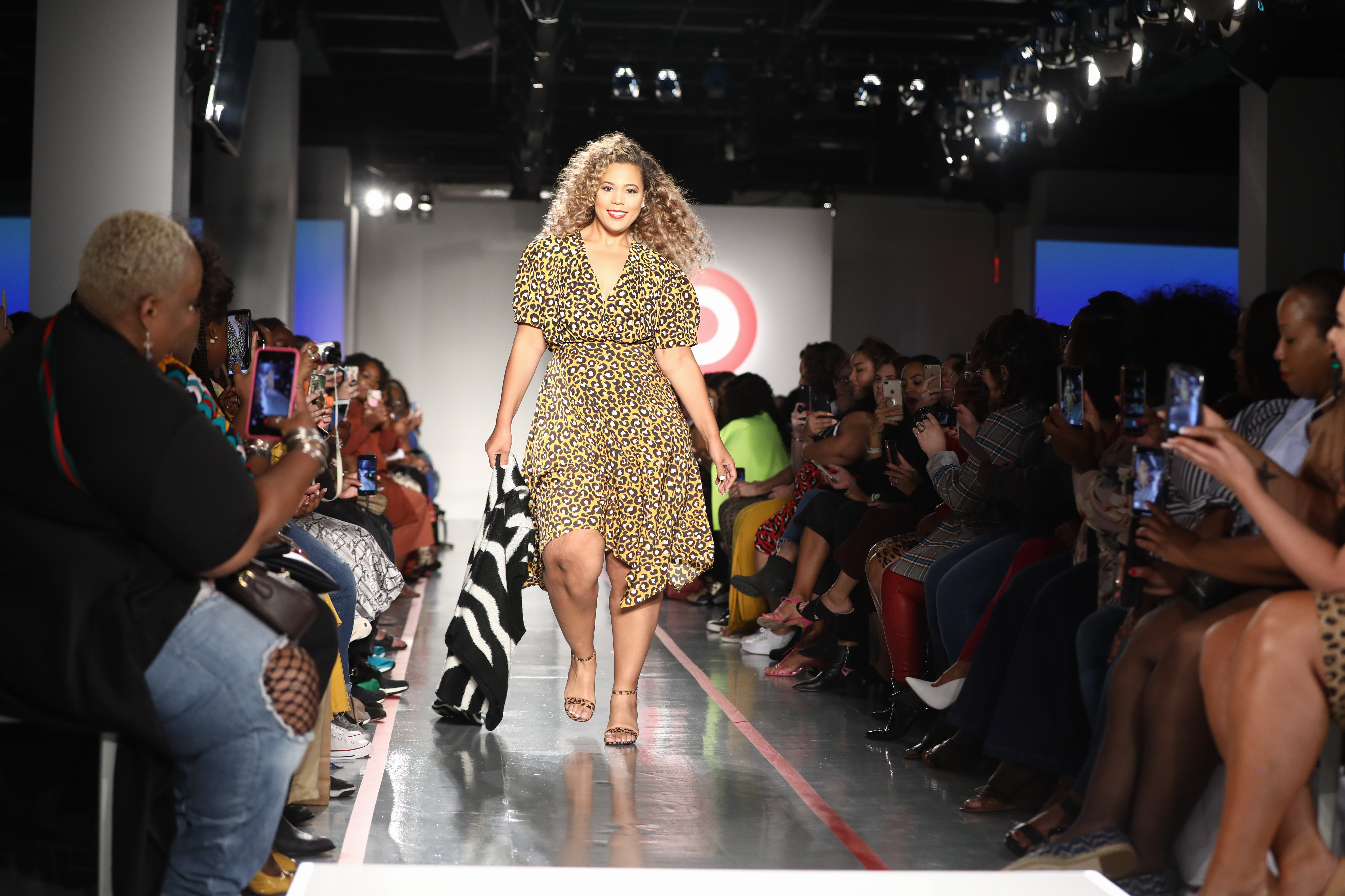 plus-size model Chastity Garner Valentine on the runway in a yellow and black leopard print dress