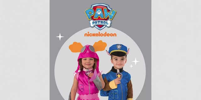 A young girl and boy in puppy costumes stand against a gray background under the PAW Patrol logo
