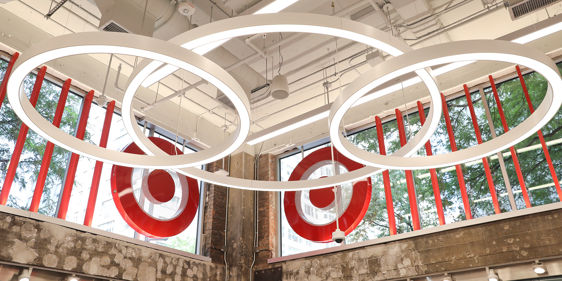Ring lights hang in the entryway of a Target store in front of a Bullseye logo