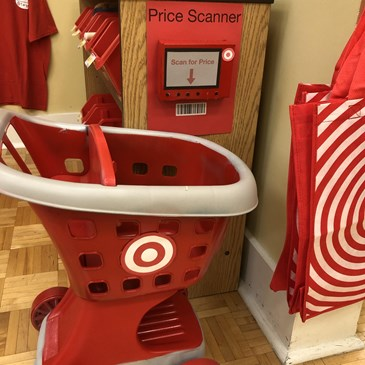 child-size red Target cart and reusable bags