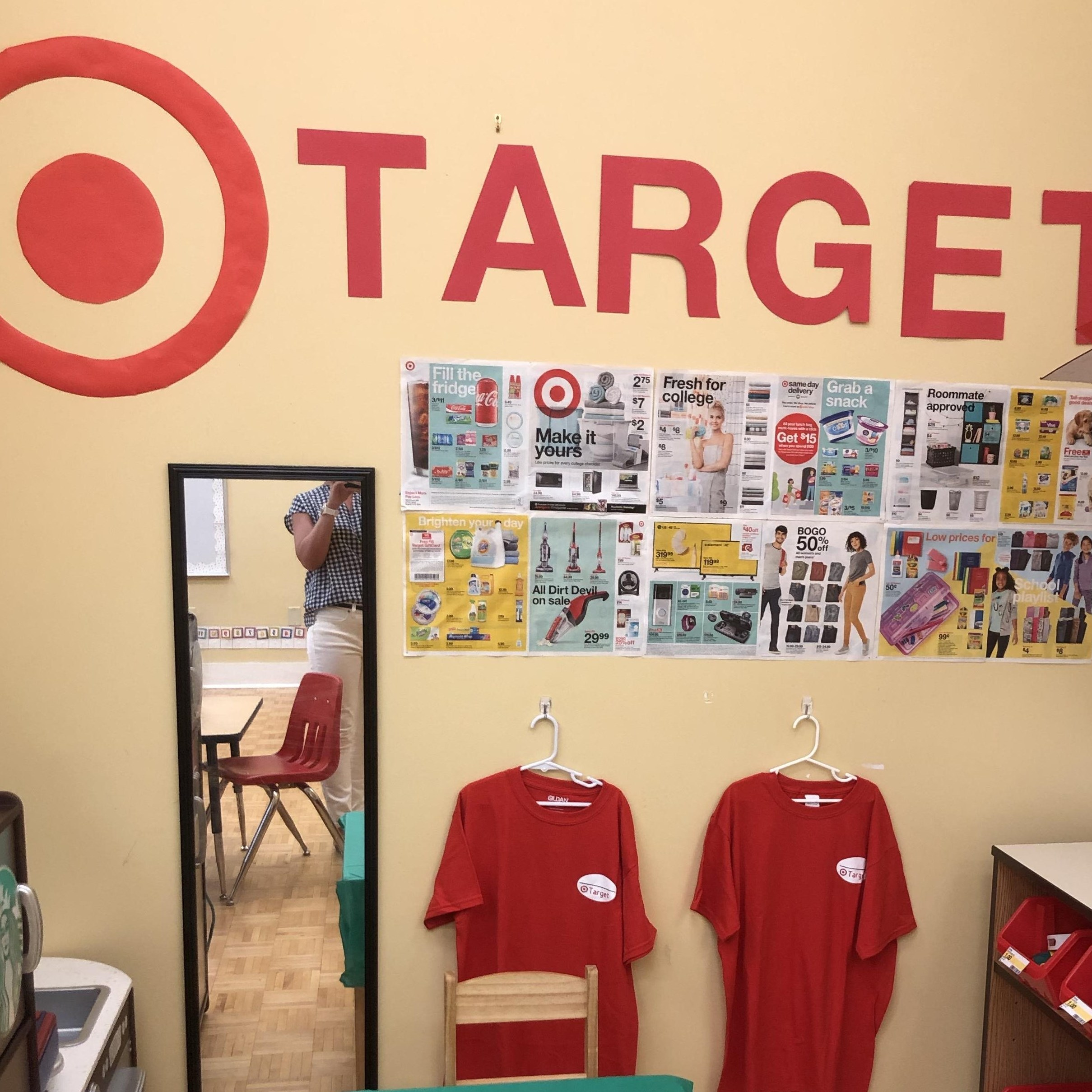 classroom corner with TARGET sign, uniforms and a mirror