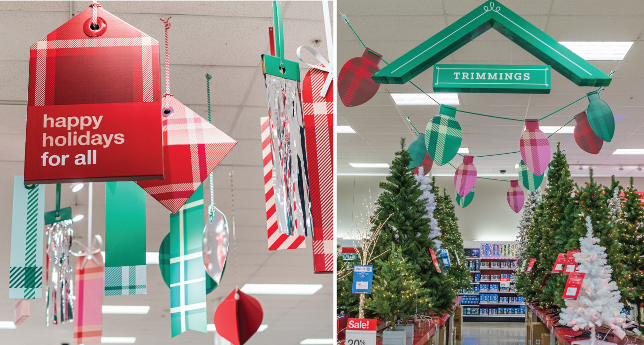 Festive plaid signs hang from the ceiling in a Target store