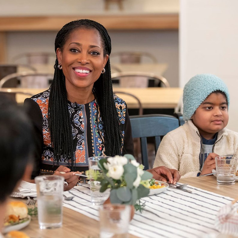 Target's Laysha Ward gathered at a table with children