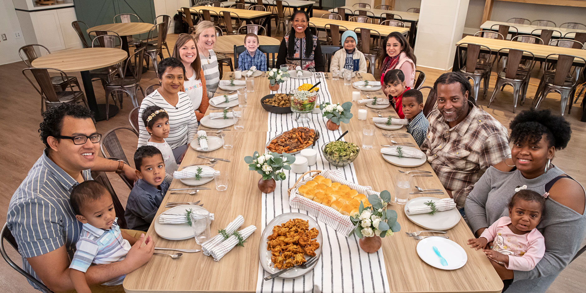 Target's Laysha Ward enjoys a meal at Target House surrounded by children