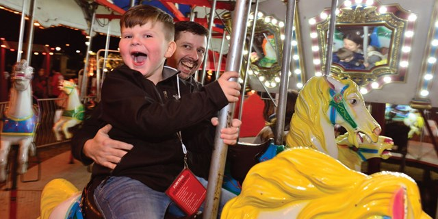 Patients and their families enjoyed a spin on the merry-go-around at the 20th Anniversary holiday ba