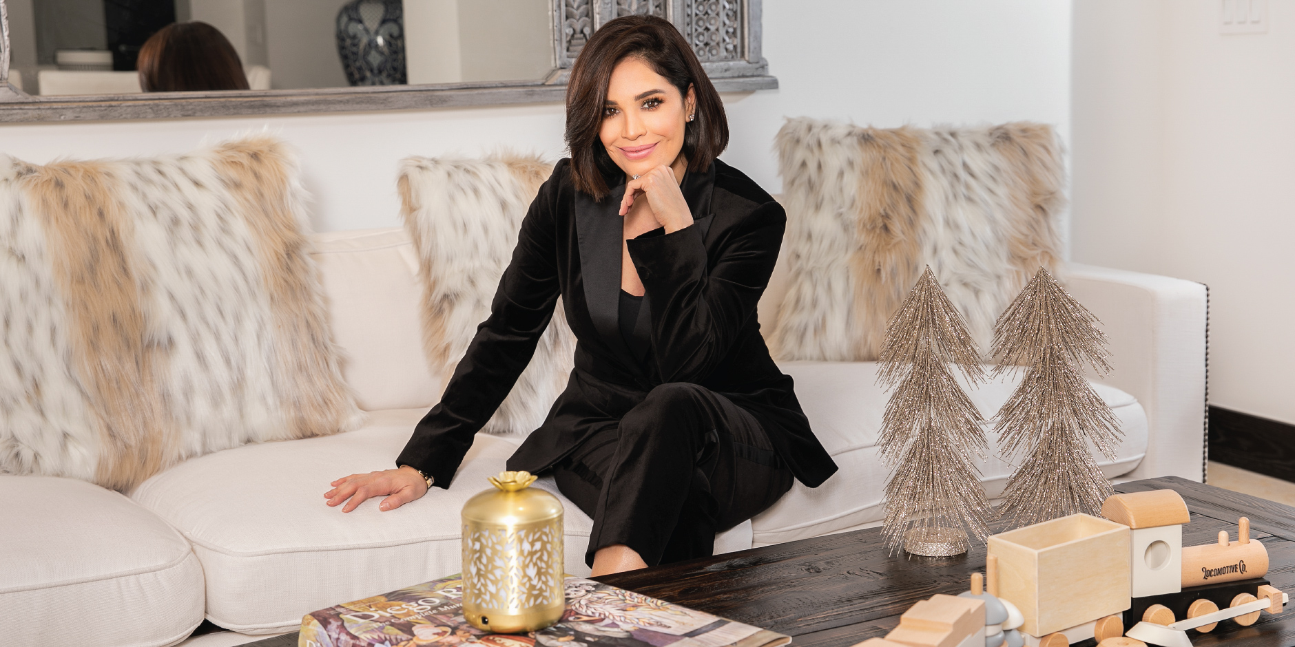 Karla Martinez smiles in an elegant living room scene