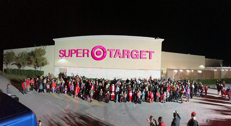 The large group of families and officers after the parade outside of the Target store.