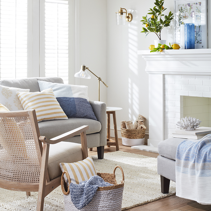 Neutral furniture is layered with soft-hued throw pillows and accents