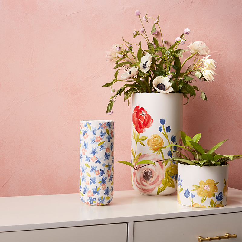 Three vases painted with floral patterns