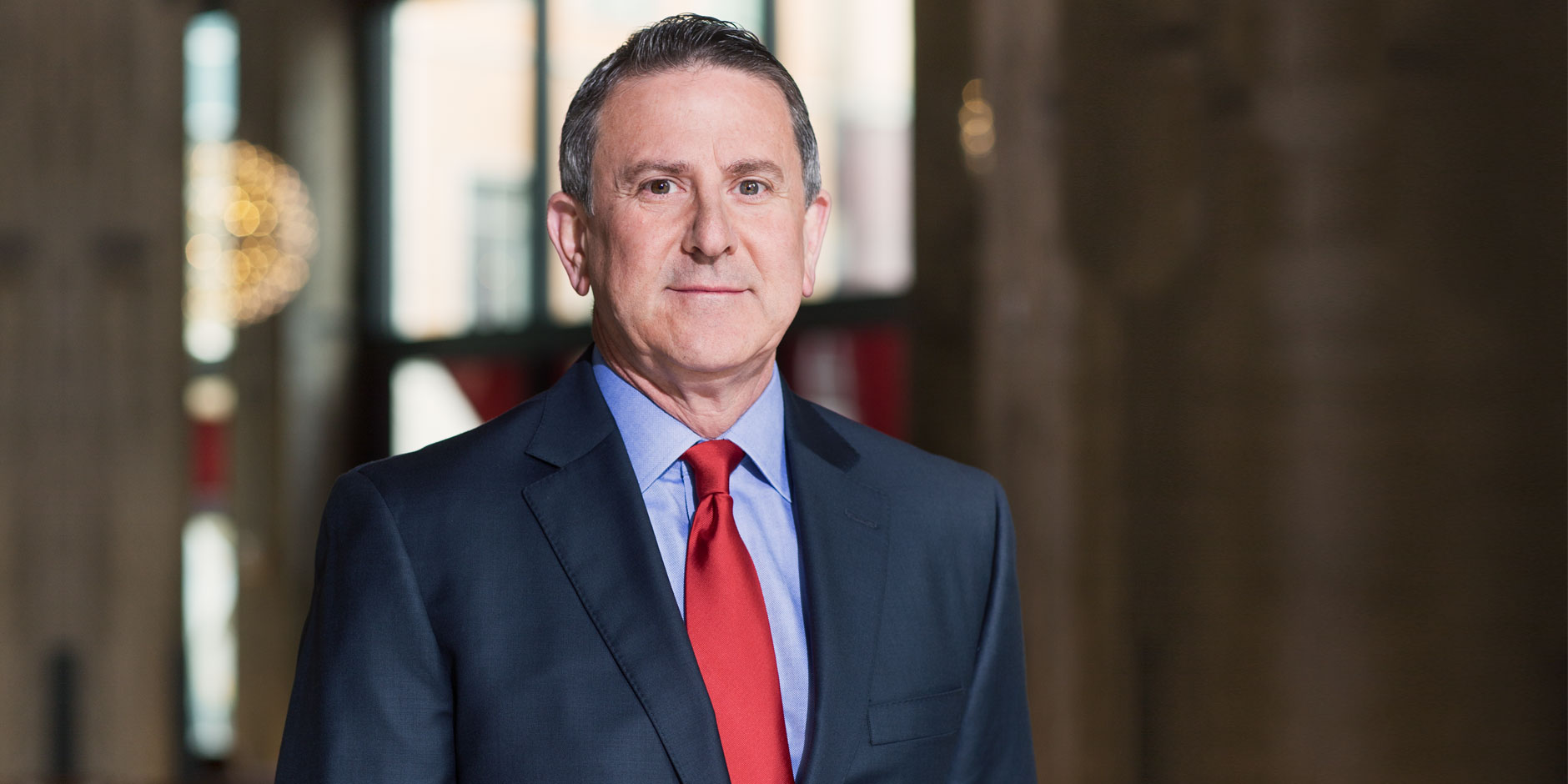 A head-and-shoulders shot of CEO Brian Cornell in a blue jacket and red tie