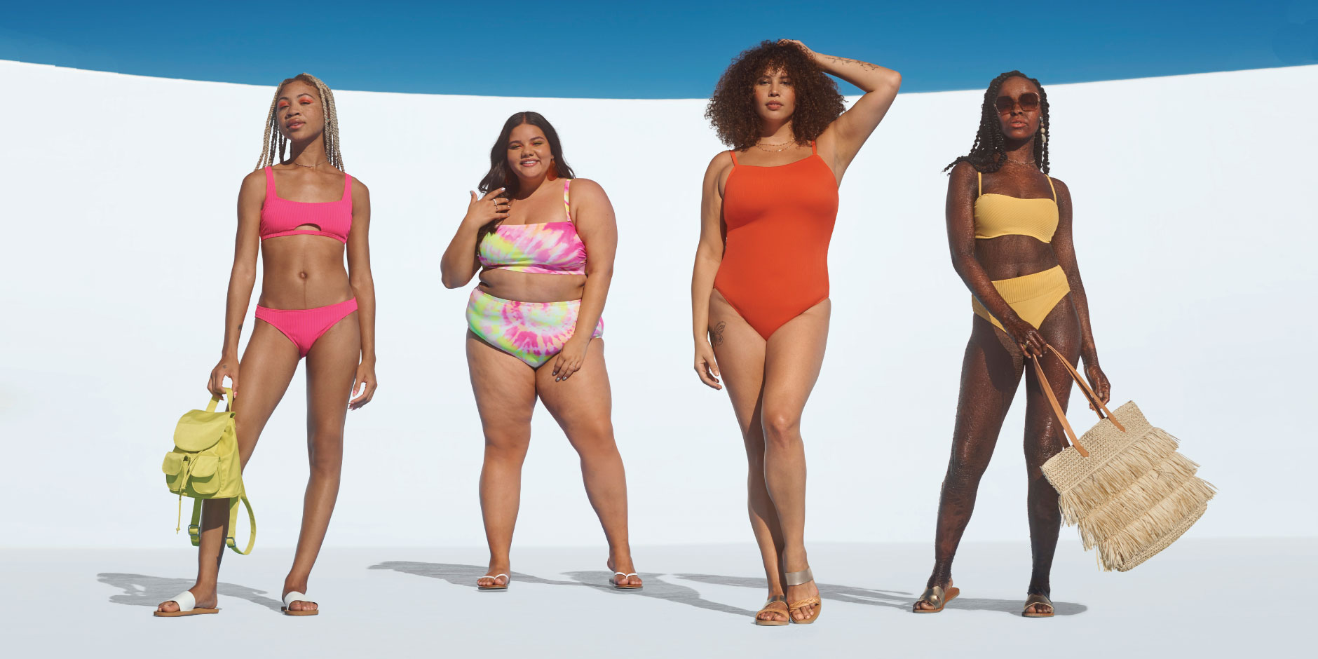 Four women wear vibrant Target swim suits