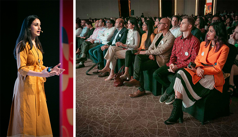 Left, Gayatri wears a yellow dress and speaks onstage; right, the audience looks on