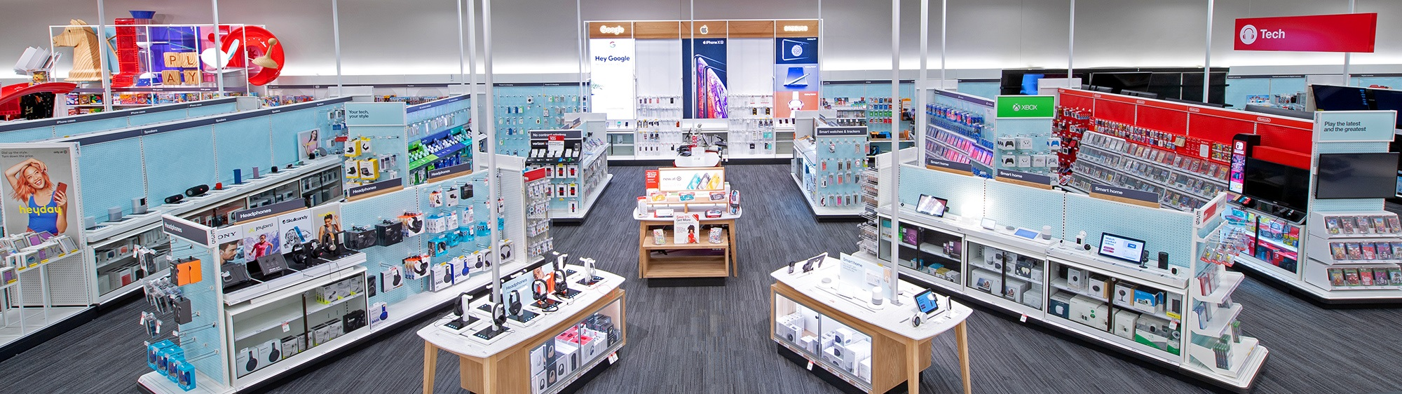 A wide shot of Target's electronics department with shelves of products on display.
