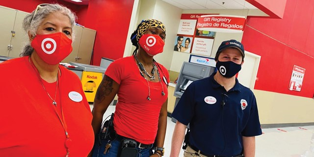 three team members wearing masks in a store