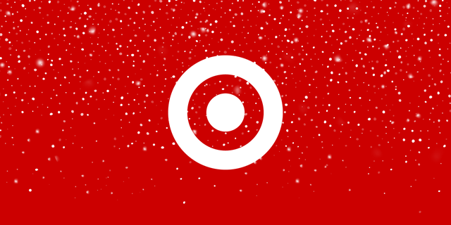 Snow falls around a white bullseye against a red background