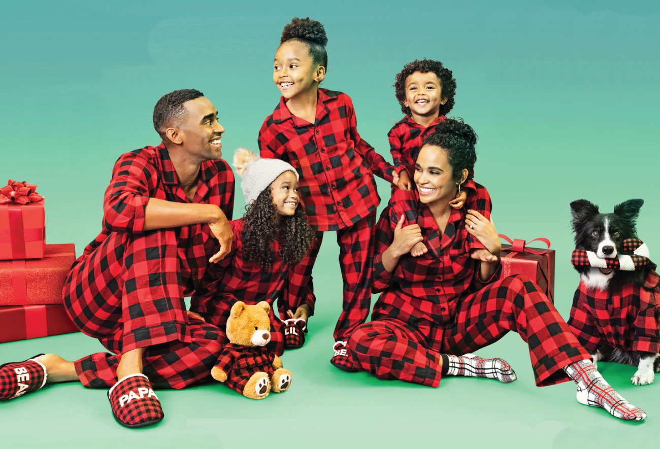 A family of five wears matching buffalo plaid pajamas