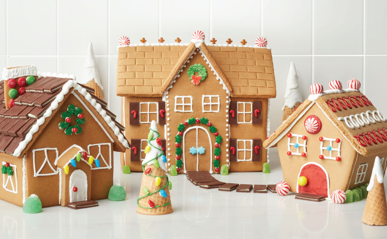 Three elaborately-decorated gingerbread houses
