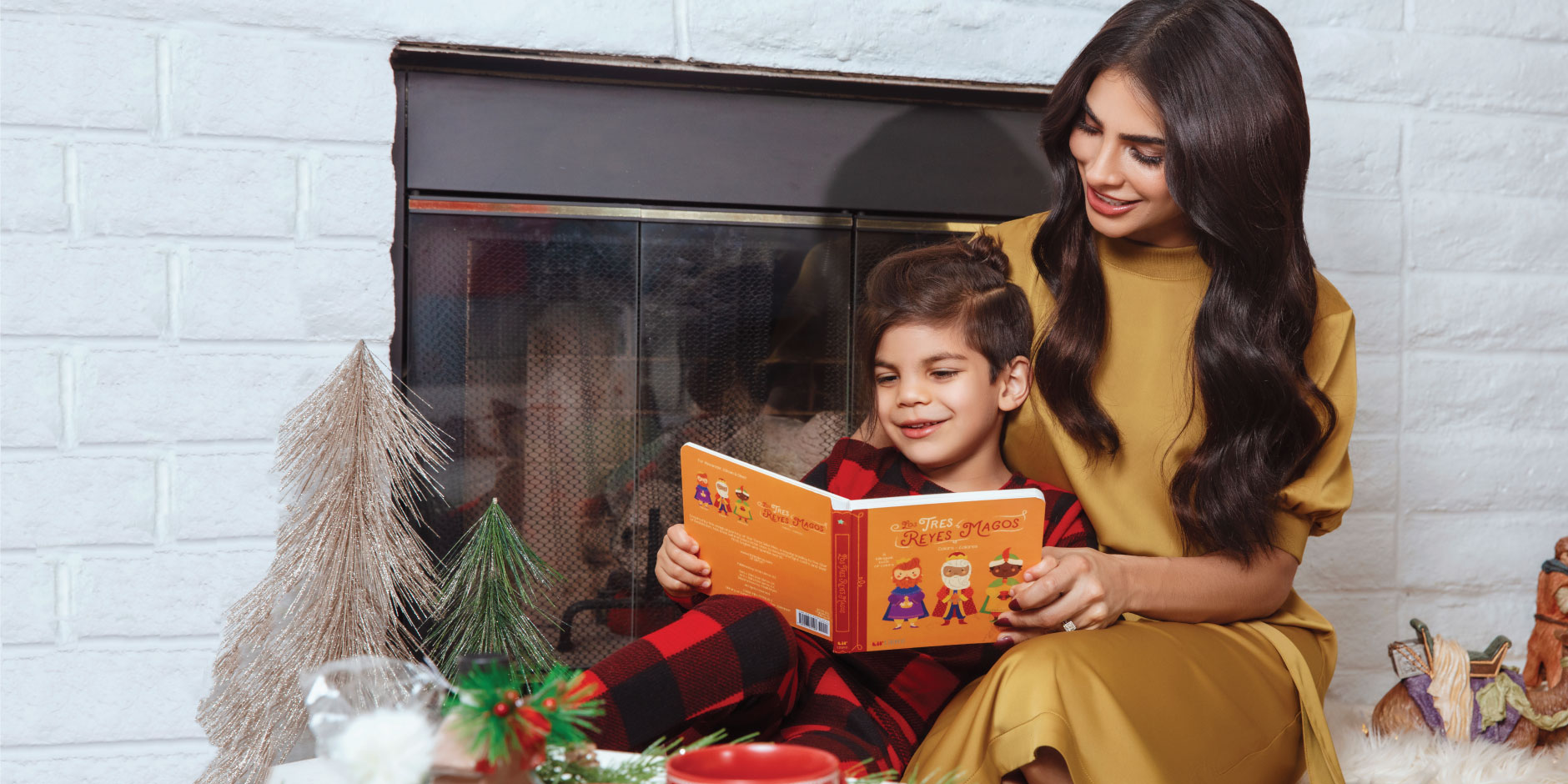 Alejandra Espinoza reads a book to her son, Matteo.